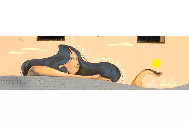 Il sole carico di metafore in un murales degli allievi del liceo artistico