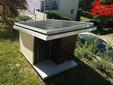 Qui anche il tetto della cuccia del cane è dotato di pannello solare